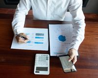 Work advice Working using a phone calculator stock images