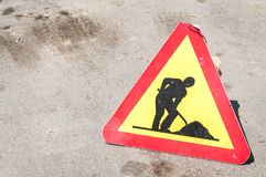 Work ahead caution or warning traffic road sign on the street stock photos
