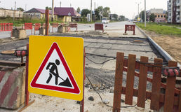 Road works ahead warning sign on the road. The work ahead warning sign on the road royalty free stock photo