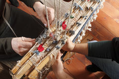 Work on ancient loom Stock Photography