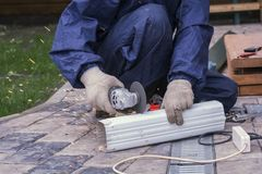 Work the angle grinder. Cut off metal detail Royalty Free Stock Images