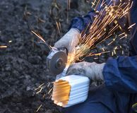 Work the angle grinder. Cut off metal detail Stock Images