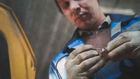 Work of automotive electrician - checking electro components in car Stock Images