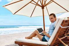 Work At Beach. Business Woman Working Online On Laptop Outdoors. Work At Beach. Successful Freelancer Business Woman Working Online In Internet On Laptop Stock Image