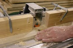 Work with Board and batten on the milling machine. Processing boards on a milling machine stock photos