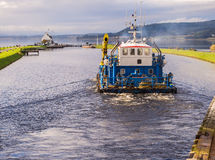 Work Boat on Calendonian Canal, Scotland Royalty Free Stock Photography