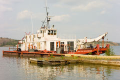A work boat tied to a dock at slave lake in the northwest territories Royalty Free Stock Photos