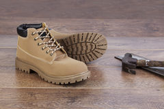 Work Boots. On wooden floor with tools royalty free stock photography