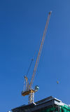 Work on a building area. Crane work on a building area Royalty Free Stock Photos