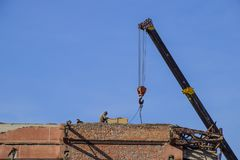 Work on the building repair, demolition of old elements. Descent Royalty Free Stock Photo