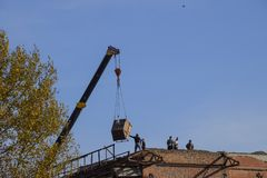 Work on the building repair, demolition of old elements. Descent Stock Images