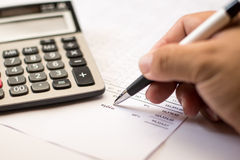 Work on the calculator and papers close up Stock Images