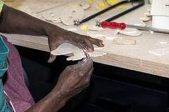Work in a carpentry workshop. Skilled young African craftsman working in a carpentry workshop with selective focus on hands Stock Photo