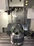 Work clamp in CNC 5 axis machine. Close up at Industrial machine Stock Images
