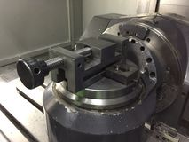 Work clamp in CNC 5 axis machine. Close up at Industrial machine Royalty Free Stock Image
