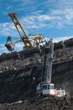 Work in coal mine. Drill, coaches and excavator Royalty Free Stock Photos