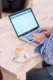 Work and coffee. The man works in the evening Royalty Free Stock Photos