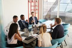 Work colleagues having a meeting in boardroom stock photography