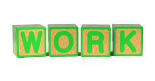 Work on Colored Wooden Childrens Alphabet Block. Stock Photography