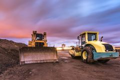 Work of compaction of rural road, later it will be asphalted. In Spain stock images