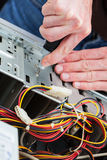 Work of computer specialist. Men repair computer with a screwdriver, closeup Royalty Free Stock Photo