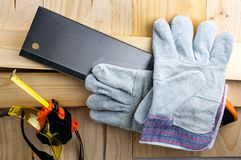 Work on the construction or repair of the house. Renovation. Use saw work gloves tape measure. Concept DIY workplace safety.  royalty free stock images