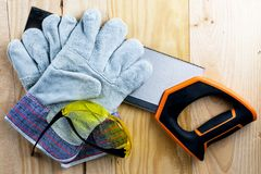 Work on the construction or repair of the house. Renovation. Use saw work gloves tape measure. Concept DIY workplace safety stock photos
