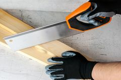 Work on the construction or repair of the house. Renovation. Use saw work gloves tape measure. Concept DIY workplace safety.  royalty free stock photo