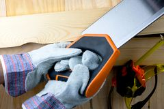 Work on the construction or repair of the house. Renovation. Use saw work gloves tape measure. Concept DIY workplace safety.  royalty free stock image