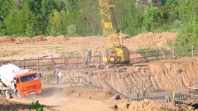 Work on the construction site. Moving trucks with concrete mixers. Work on the construction site. Moving trucks with concrete mixers stock video