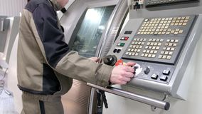 Work on the control panel of machine CNC. Metalworking milling machine. Cutting metal modern processing technology. Work on the control panel of machine CNC stock footage