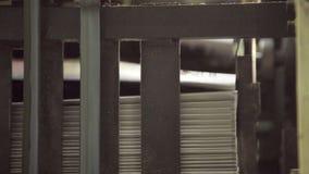 Work of conveyor in printing plant, part of newspapers. stock video