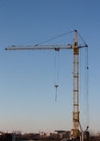 Work crane at a construction site of homes. Royalty Free Stock Photography