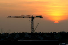 after work, cranes and sunrise Stock Photo