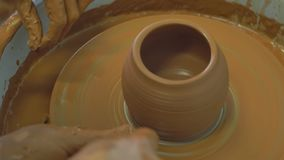 Work on creating a jug. Making a vase by hand, Creative work in the workshop stock video