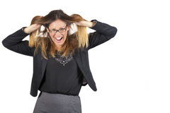 Work crisis. Woman pulling hair on white background. A beautiful business woman pulling her hair. She is stressed by the workload. With black-rimmed glasses Royalty Free Stock Photo