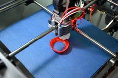 Work 3d printer close. Printing 3D printer Object Orange plastic On blue background. Plastic Wire Filament, Modern printing technology. Progressive additive royalty free stock photos