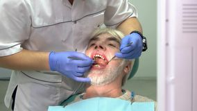 Work of dentist, senior patient. stock video footage