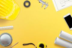 Work desk of the architect or builder with all the necessary tools, projects and instruments for measurement. Free space in the middle for text. Top view stock photography