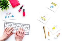 Work desk of beauty blogger with social media icons and cosmetics on white background top view copy space. Work desk of beauty blogger with social media icons Stock Images