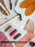 Work desk of clobber. Skin and tools on grey wooden desk background top view Stock Images