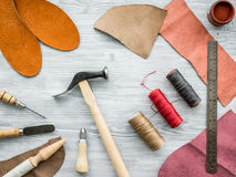Work desk of clobber. Skin and tools on grey wooden desk background top view Stock Photo