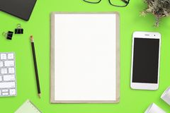 Work desk with empty paper on folder for sketch mockup. royalty free stock photo