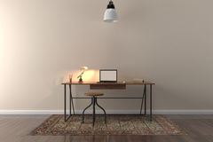 Work desk in empty room with big wall in background Stock Photos