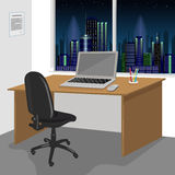 Work desk interior with a laptop computer and window with night city scenery Stock Images