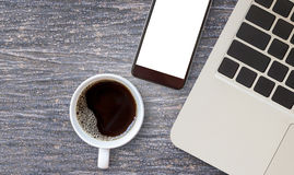 Work desk with laptop computer and hot coffee cup. Stock Image