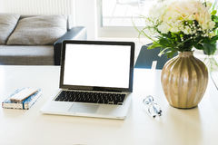 Work desk with laptop. Copy space on blank screen Royalty Free Stock Photo