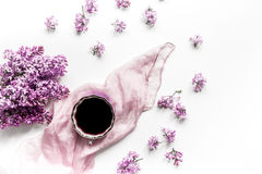 Work desk with lilac flowers in home office on white background top view stock image