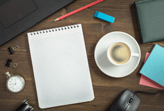 Work desk with opened notebook and coffee Royalty Free Stock Photography