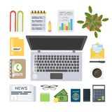 Work desk top. Laptop and newspaper, calculator and notebook and more Royalty Free Stock Photography
